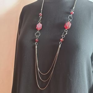 Long red and burnt silver necklaceLong red and bur